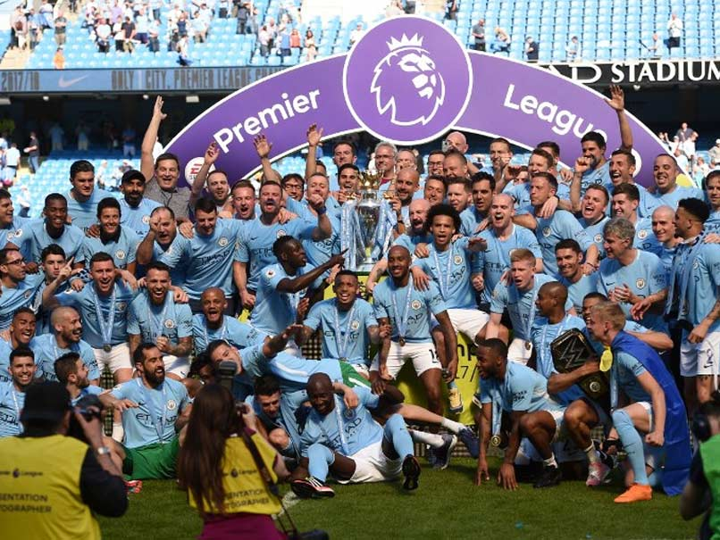 Image result for Manchester City lifts the Premier League Trophy After Draw with Huddersfield