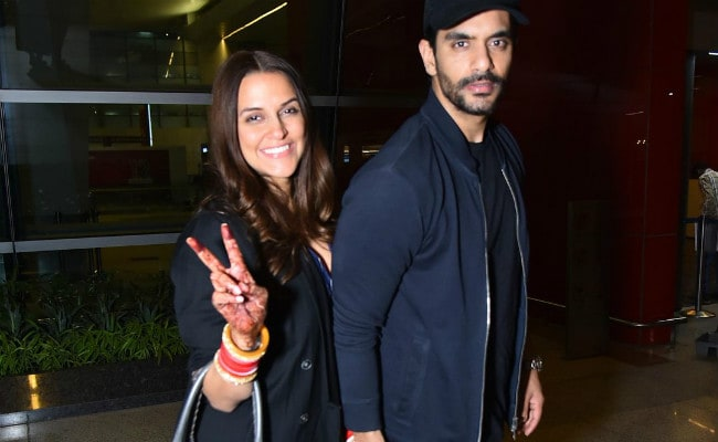 Neha Dhupia's 'First Flight With Husband' Angad Bedi. See Airport Pics