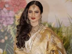 The Sonam Kapoor Effect? Rekha, 63, Stunned Us In Gold Pant-Style <i>Saree</i>