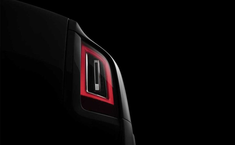 A bulging fender and simplistic taillight design is what we see in the first teaser image for RR Cullinan