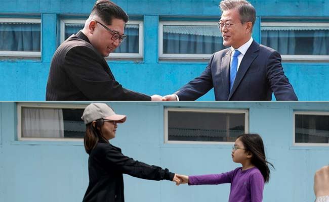 Tourists Re-Enact Famous North And South Korea Handshake At Replica Border Village