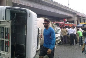 Car crushed as cement mixture truck falls on it from flyover bridge