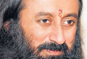 NRI accuses Sri Sri Ravishankar of grabbing land