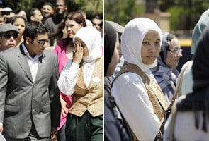 Muslim Disneyland employee says she was forced to remove head scarf
