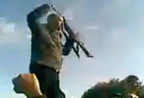 Caught on camera: Gaddafi's son brandishing a machine gun