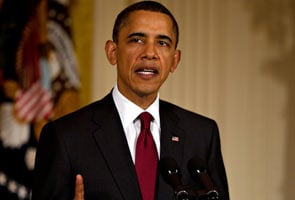 Stop attacks on civilians or face military action, Obama warns Gaddafi