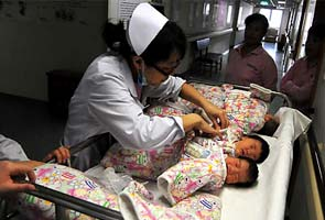 Chinese couple with eight test tube babies faces hefty fines