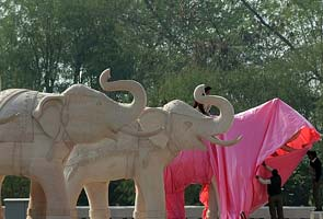 With just one day to go, covering up statues of Mayawati, elephant begins