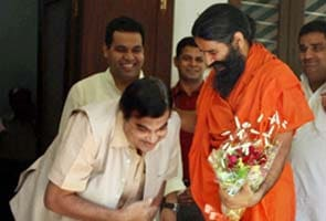 At meeting, BJP President Nitin Gadkari touches Baba Ramdev's feet