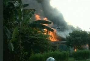 Nine die as Indonesian Air Force plane crashes into housing complex