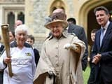 Queen Elizabeth II greets Olympic torch at Windsor Castle