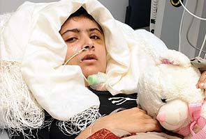 Malala better, asks for books; father vows she'll return to Pakistan