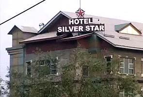 Militants open fire outside hotel in Srinagar, one person killed