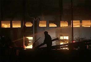 Families await bodies after Pakistan factory fire