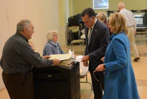 Romney casts ballot, campaigns as people vote