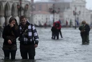 Three die in Italy floods as heavy rain continues