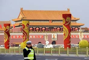 China begins transfer of power amid infighting and public spectacle