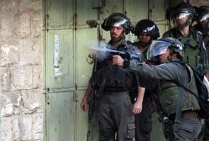 Israel raids kill 31 in Gaza as truce efforts intensify
