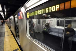 Superstorm Sandy: Death toll rises as New York subway rolls again