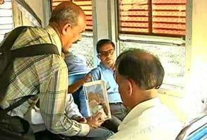 Why this Professor begs on Mumbai trains