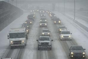 Hundreds of flights cancelled after major snowstorm in US Northeast
