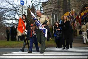 Silence, ringing of bells to honor victims of US school massacre