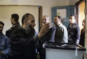 Divided Egypt votes on new constitution