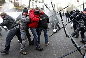 ArcelorMittal workers and police clash outside Belgium PM's house