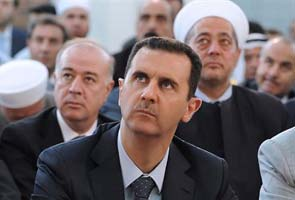 Syrian President Bashar al-Assad moves to warship guarded by Russians, say reports