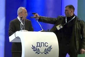 Man holds pistol at Bulgaria politician's head during speech