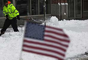 US Northeast digs out from blizzard, storm brewing in plains