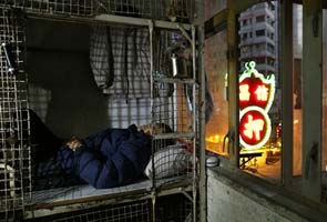 In wealthy Hong Kong, the poorest live in metal cages