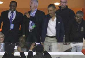 Barack Obama plays golf, attends college basketball playoff game