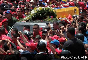 Hugo Chavez's body brought 'home' to military academy