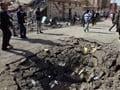 Iraq attacks kill 12, wound 165