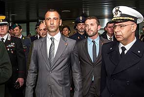 Italian marines charged with murder will return to India to face trial