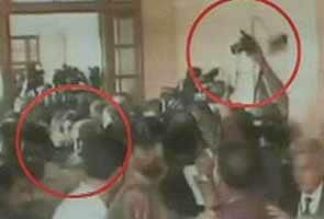 Pervez Musharraf barred from leaving Pakistan; lawyer throws shoe at him in court