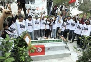 Tunisians mark 40 days since political killing of leader