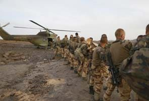 France looks to cut armed forces but keep military clout