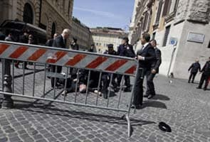 Two police officers shot as Italian government sworn in