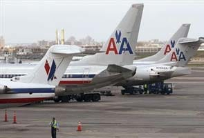 American Air says systems restored, expects more cancellations