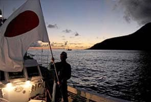 Japan vows to use force if China land on disputed islands