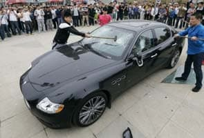 China owner smashes up Rs 2 crore Maserati in protest over poor service