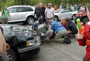 Up to 60 injured after car drives into US parade