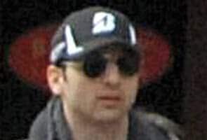 Boston Marathon bombing suspect died of gunshots, trauma: reports