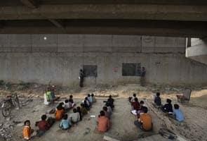 For India's poor, a school under a railway bridge