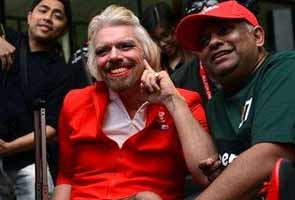Richard Branson dresses up as air hostess after losing bet
