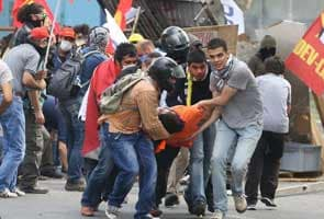 Turkey's Prime Minister rejects 'dictator' claims as fresh clashes break out in Istanbul
