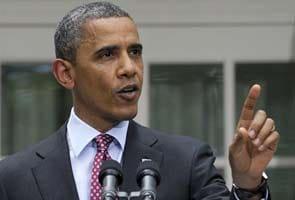 Barack Obama defends economic vision, as battles loom