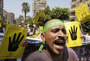 In Egypt, thousands of Mohamed Morsi supporters march amid heavy security